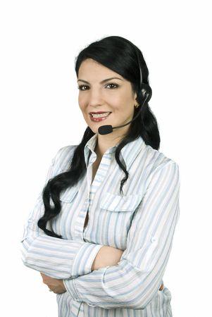 mains crois�es: Belle femme op�rateur travaillant dans un centre d'appel permanent avec les mains crois�es et souriant Banque d'images