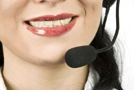 gladly: Close up of woman face with headset,helpdesk agent smiling  Stock Photo