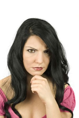 sulky: Beautiful brunette angry woman standing sulky with hand at chin isolated on white background Stock Photo