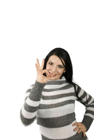 Attractive brunette woman showing a big OK sign and smile isolated on white background and copy space  photo