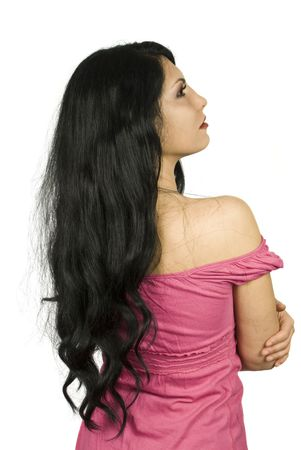 Back of  brunette woman showing her long hair standing with hands crossed and looking up isolated on white background photo