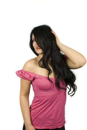 Sensual young woman standing with her hand in hair and looking at you  photo