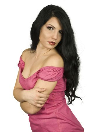 Attractive young brunette  woman with long hair posing with hands crossed  photo