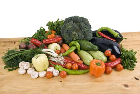 Variety of fresh vegetables garden stuff on kitchen wood table  photo