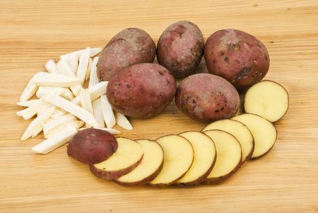 ripper: Red potato whole,slice and ripper on wood table background