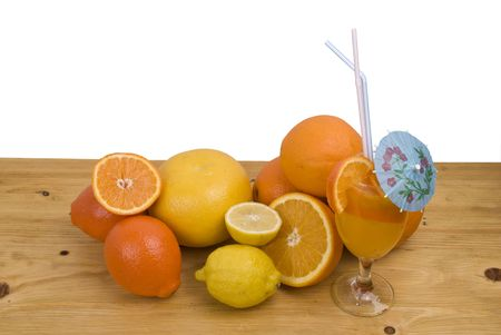 Citrus fruits orange,tangerine ,lemon and grapefruit and a glass with tropical  fruits juice isolated on wood table in kitchen photo