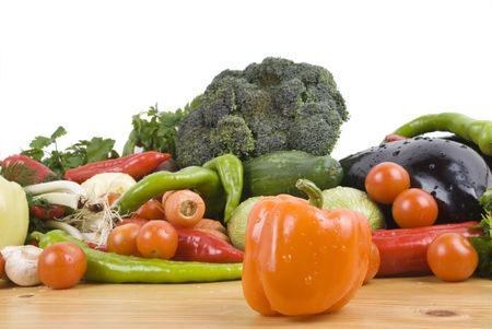 Fresh vegetables on wood table ,orange pepper in front of image photo