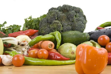 Fresh mix vegetables on wood table in kitchen,orange pepper in front of image photo
