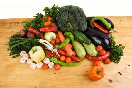 Variety of fresh vegetables on wood table in kitchen,seen from above photo