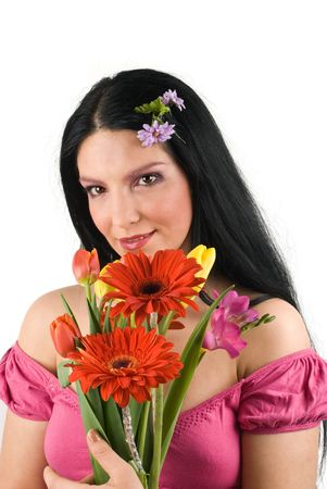Beautiful young woman with pink make up  holding a spring bouquet of various flowers ,smiling and looking at camera isolated on white background photo