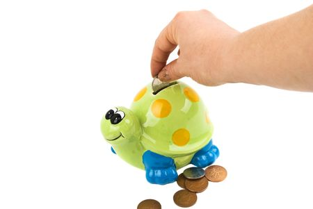 Woman hand save the money in her money box tortoise isolated on white background Stock Photo - 4491511
