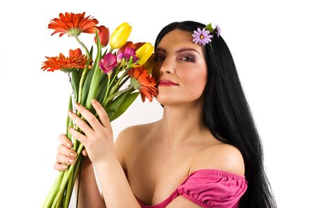 Beautiful spring woman holding fresh flowers near  her face  isolated on white background photo