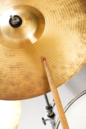 Close up of cymbal set and drumstick indoor shot photo