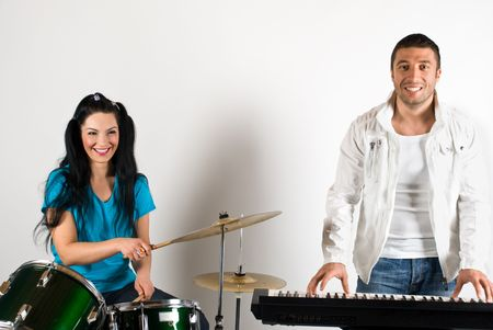 Happy musical band with man and woman playing drums and organ Stock Photo - 4564310
