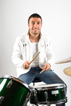 Happy drummer with big smile playing drum set  photo