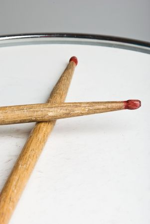 Close up of old wood drumsticks on a drum Stock Photo - 4589956