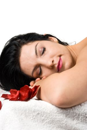 Close up of beauty woman face  relaxing at spa massage isolated on white background photo