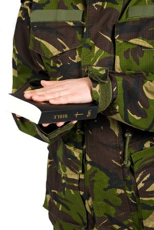 camouflage woman: Soldier in the army swear with hand on bible to defend the country isolated on white background