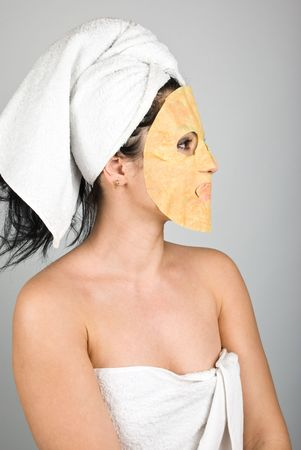 Woman profile with nutritious paper   mask looking away photo