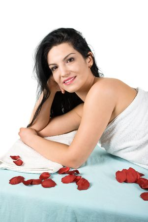 Beautiful brunette woman lying on massage table at day spa  photo