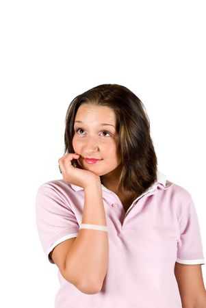 Teenager  holding her hand at chin ,smiling and  thinking or maybe listening someone  isolated on white background Stock Photo - 4731279