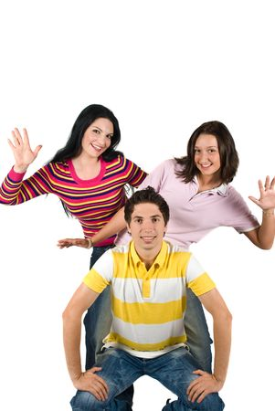 Cheerful three young friends standing in a funny position and showing happiness,copy space for text ,white background photo