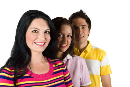 Three smiling  young people friends standing in a line,focus on first woman,white background and copy space for text photo