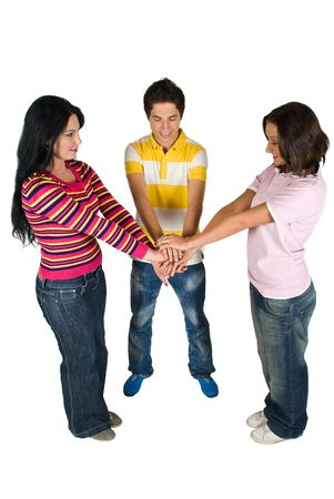 Three happy friends showing unity and put their hands together Stock Photo - 4768299