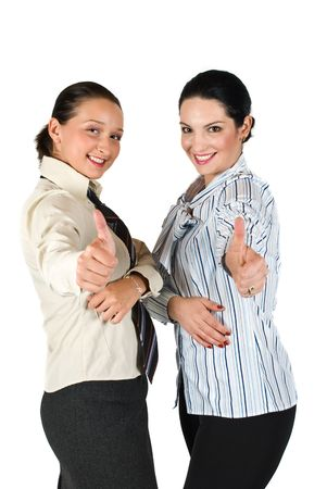 Two beautiful business woman giving thumbs up concept of successful partnership,isolated on white background photo