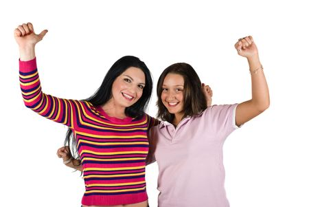 Two beautiful woman with hands up won something and they are happy of victory photo