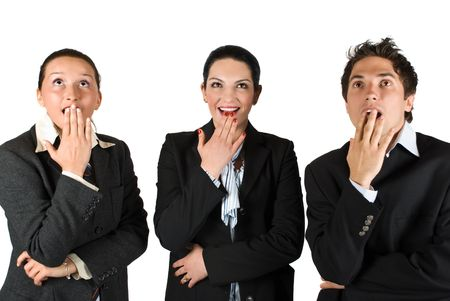 Three business people standing in a line  looking up  and they look very surprised and happy  about something and  exclaim :Wow! and holding them hands at mouths