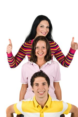 Three happy people  friends standing in a line one above the other or overhead each other and brunette girl giving thumbs up cocept of successful friendship photo