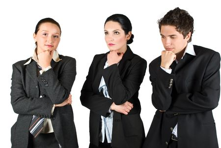 disillusioned: Group of three worried workers standing with hands crossed and thinking at future or  problems Stock Photo