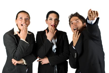 Group of three business people  with surprised face standing in a row  looking up and pointing somewhere  photo