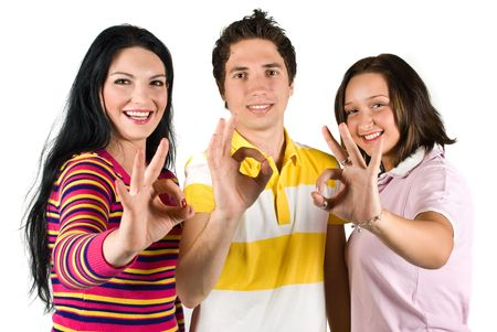 Group of three friends showing okay sign and laughing together isolated on white background photo