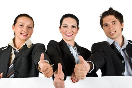 Business team showing a group of three thumbs up and holding a white billboard photo