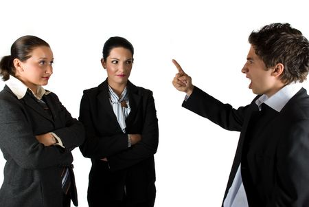Angry boss businessman screaming and pointing to his colleagues businesswoman who listen him shocked photo