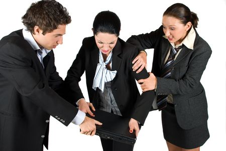 A very nervous businesswoman want to broke a laptop because bad business and her colleagues try hard to stop her .Can be a fight for laptop also Stock Photo - 4843763