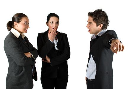 Mad businessman boss screaming :You are fired! and pointing out at two employees woman,the brunette businesswoman it is shocked and surprised and put her hand at mouth and the other making a smiley face like she say:What?