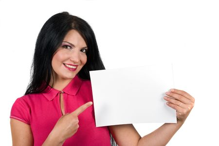 Beautiful brunette woman holding a blank page and showing with her finger to the copy space isolated on white background photo