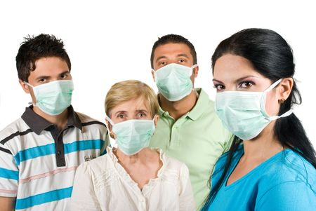 Young woman with protective mask standing in profile and in front of image looking at you and other three people with mask near her concept of protection from sickness photo