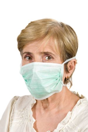 Portrait of senior woman with protective mask isolated on white background photo