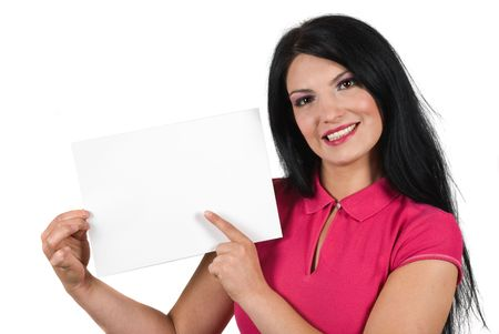 Beautiful smiling woman holding a blank sign and pointing with her finger to copy space isolated on white background photo