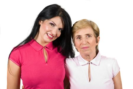 Adult daughter and senior mother standing closer one to each other and smiling isolated on whit background Stock Photo - 5009951