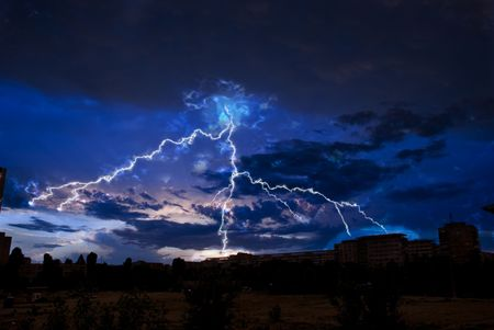 Lightning and storm clouds over the city evening Stock Photo - 5022457