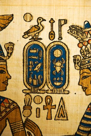 Close up of papyrus showing king and queen in profile with egyptian  hieroglyphics symbols photo