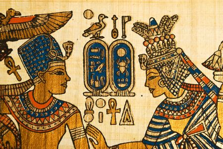 Papyrus showing king and queen in profile with egyptian  hieroglyphics symbols photo