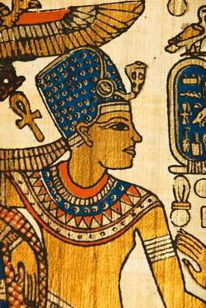 ancient civilization: Close up of Egyptian history papyrus showing a king and  hieroglyphics painting with golden and blue color Stock Photo
