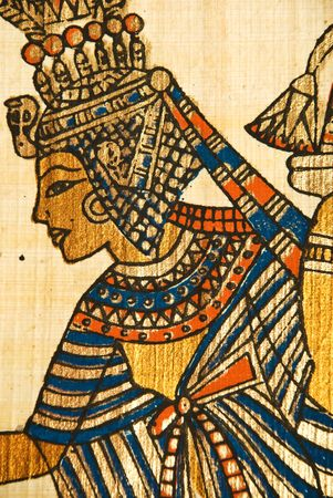 Close up of  ancient Egyptian scroll showing a queen painting in golden color photo