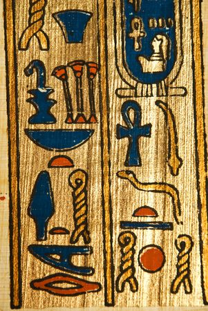 Close up of Egyptian hieroglyphics on ancient  papyrus painting on golden Stock Photo - 5060887